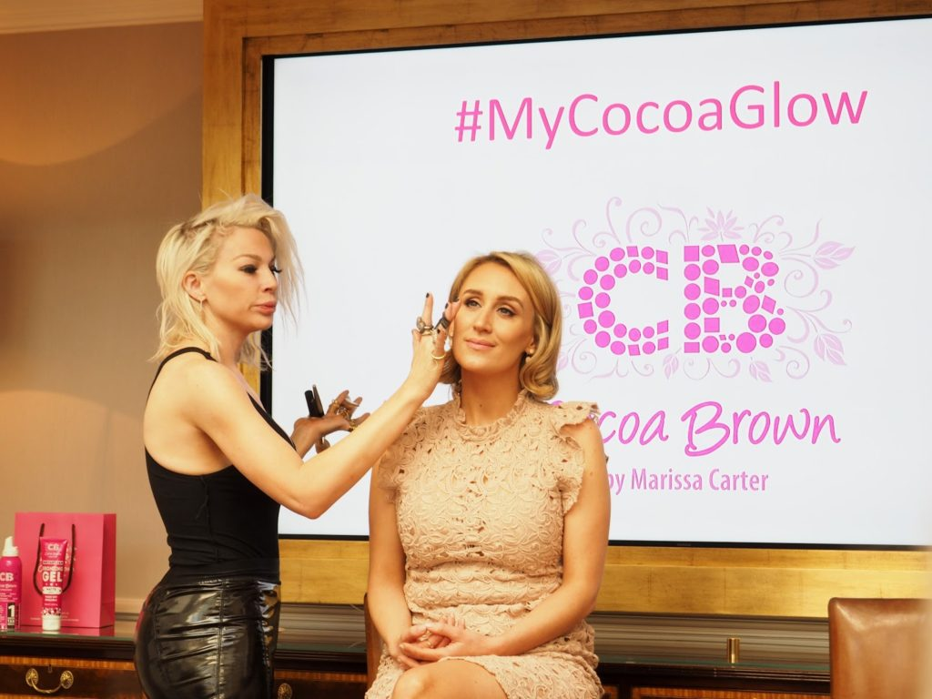Cocoa Brown Masterclass & Golden Goddess Oil Review - Joyce Bonelli applying Golden Goddess Oil on Marssa Carter
