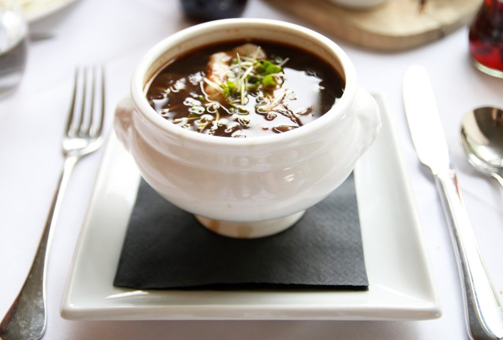 The Governor's Classic French Onion Soup starter at Marco Pierre White Steakhouse Double Tree by Hilton Cambridge